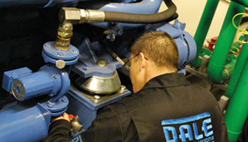 dale power solutions staff member servicing generator