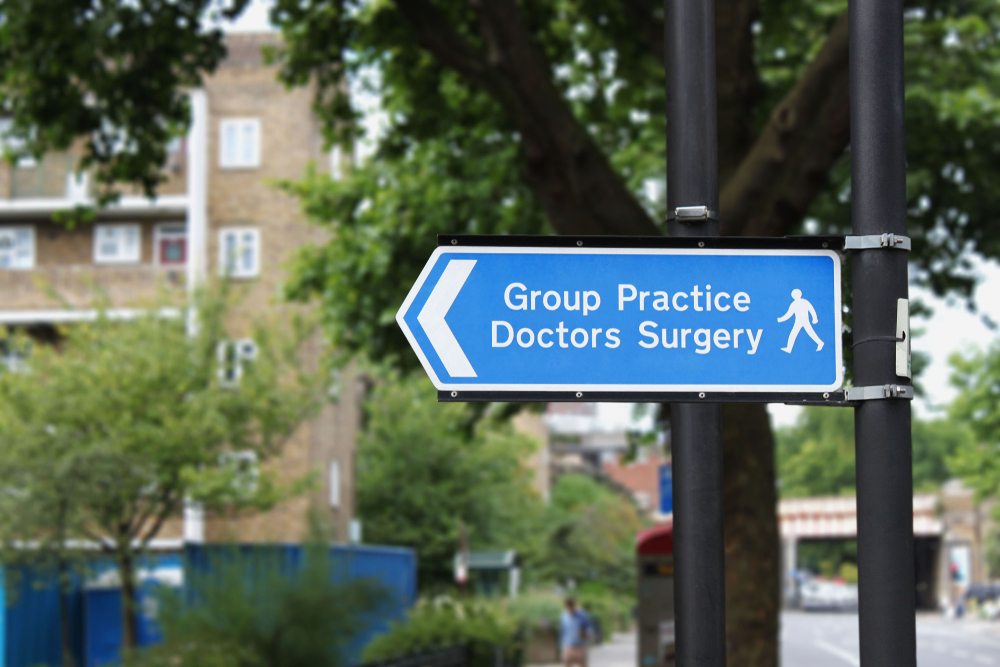 Sign showing way to Group Practice and Doctors Surgery